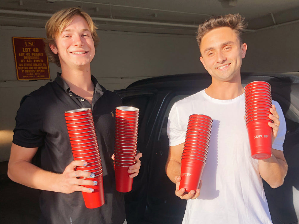two frat brothers holding supcups