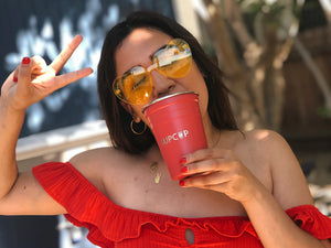 Load image into Gallery viewer, girl with yellow heart sunglasses holding party cup
