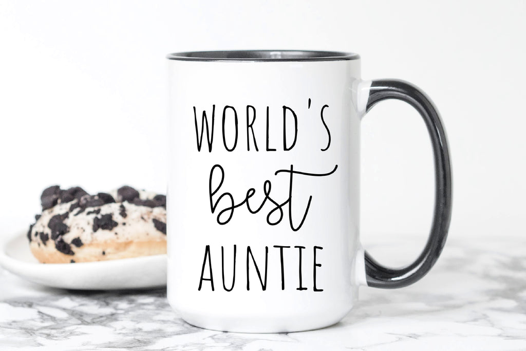 White ceramic coffee mug with black handle and black inside that says World's Best Auntie in large black text