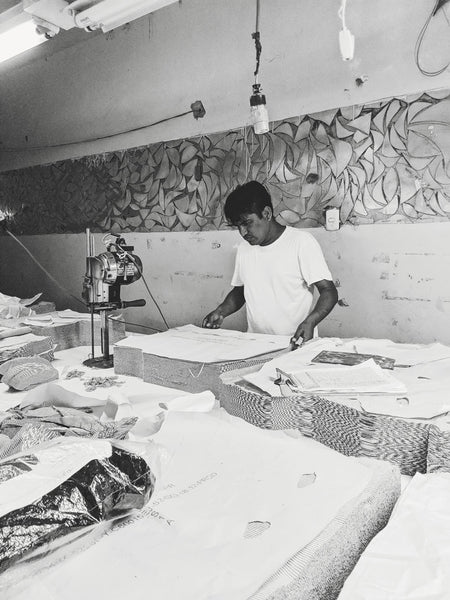 Juan cutting our pima cotton fabrics by mimi & august