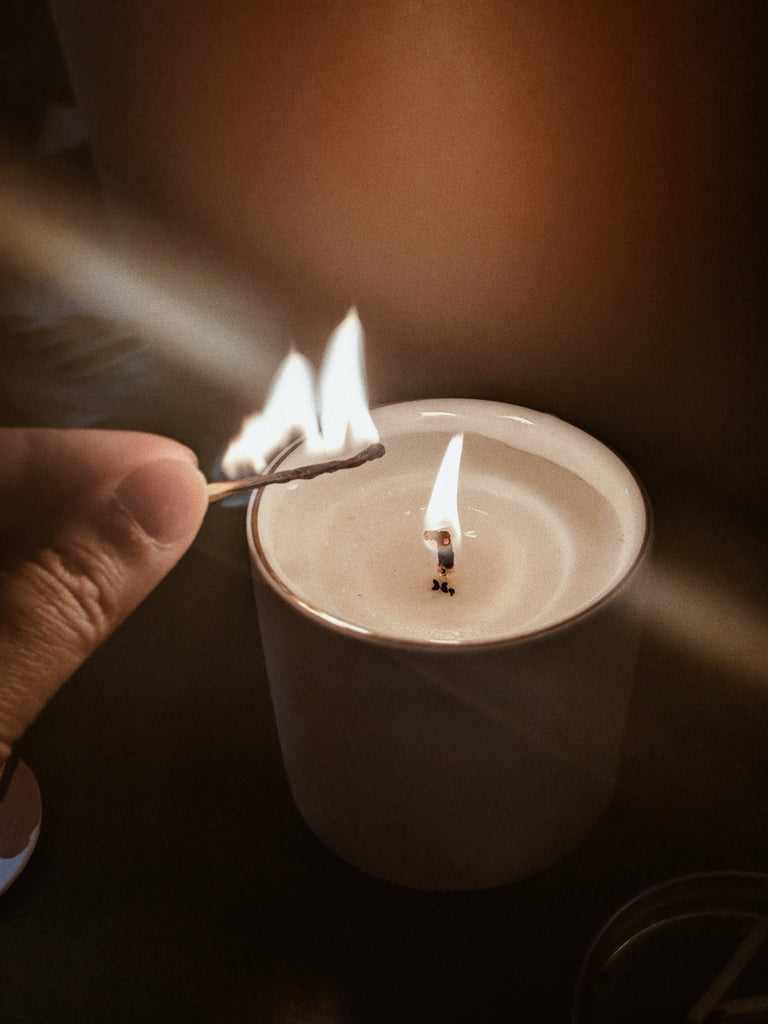 Sustainable candle lit by mimi & august