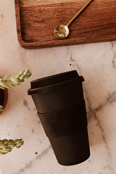 Drinking coffee in the Black Matte Reusable Bamboo Café Yo Cup mimi & august