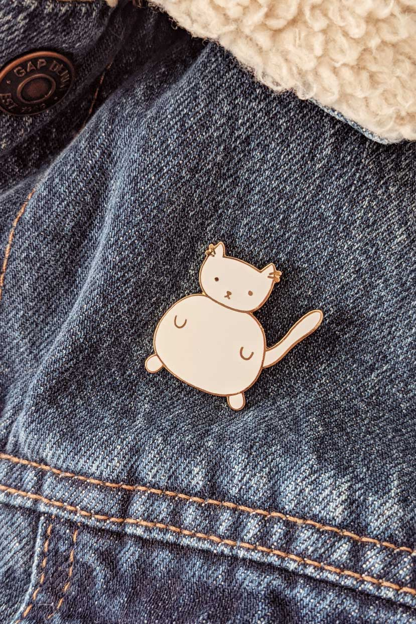 The smallest and cutest cat you can bring anywhere enamel pin by mimi & august