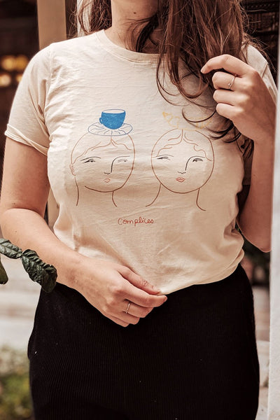 Women wearing the complices t-shirt by Isabelle Feliu x Mimi & August