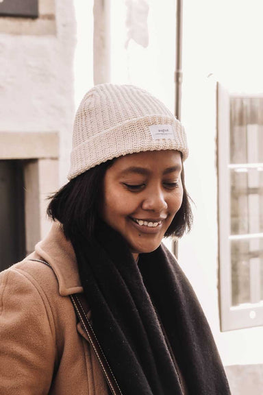 wearing the natural waffle recycled cotton beanie by mimi & august