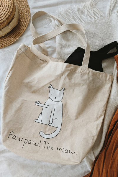 Paw paw tes miaw reusable tote bag lay in bed by mimi & august