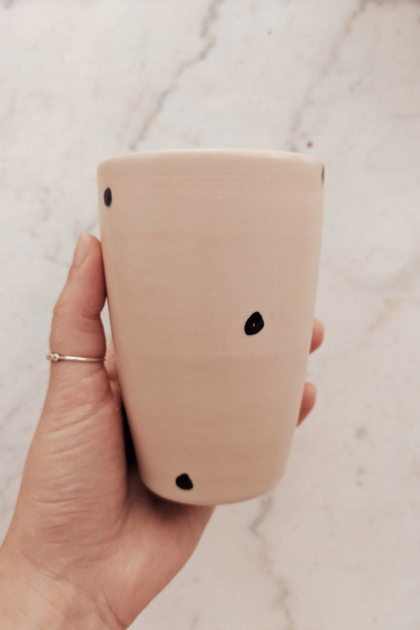 Polka Dots Mug Pottery Coffee Cup in hand by Mimi and August