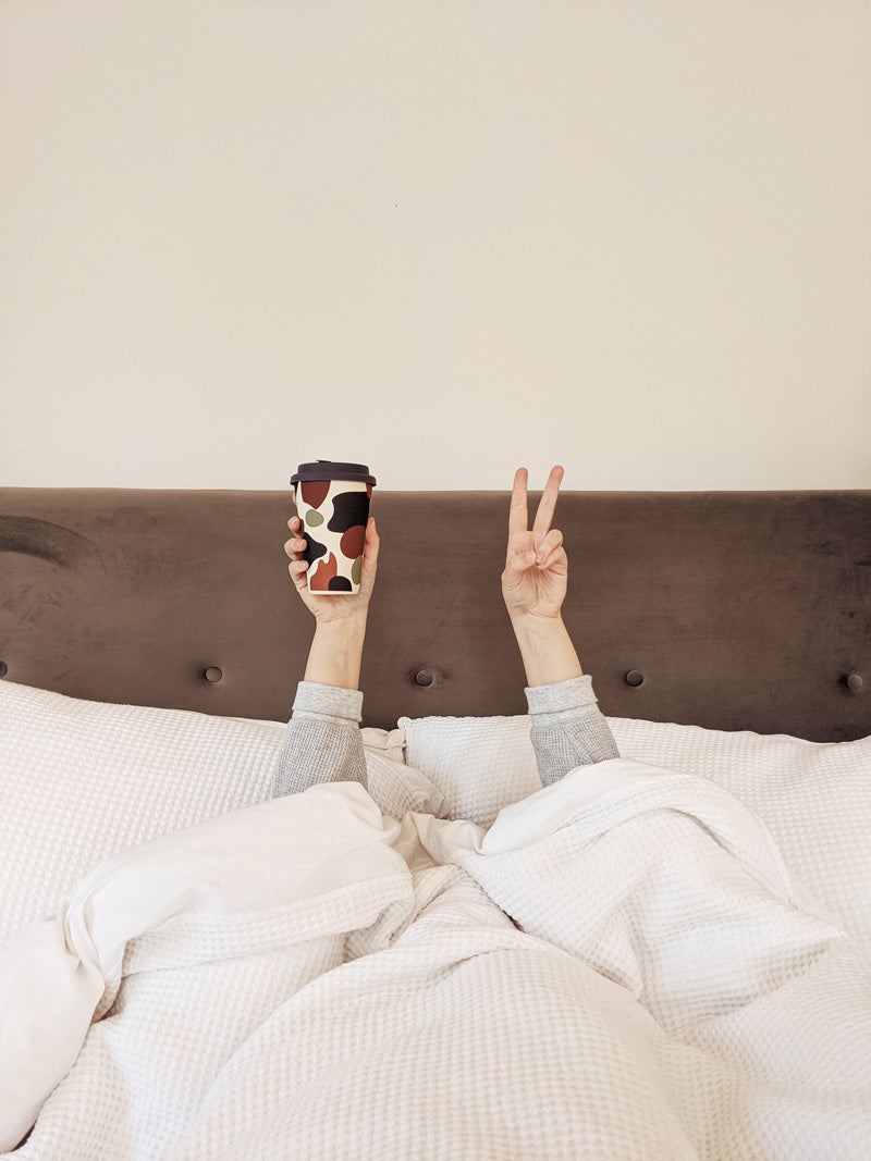 morning coffee in bed with the reusable bamboo shapes cup by mimi and august