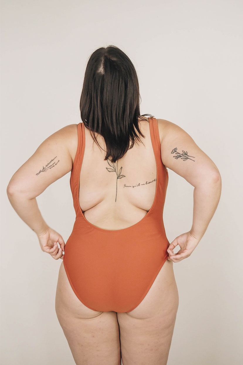 Women with tattoo wearing the Riad Tamarindo One Piece Swimsuit by Mimi & August