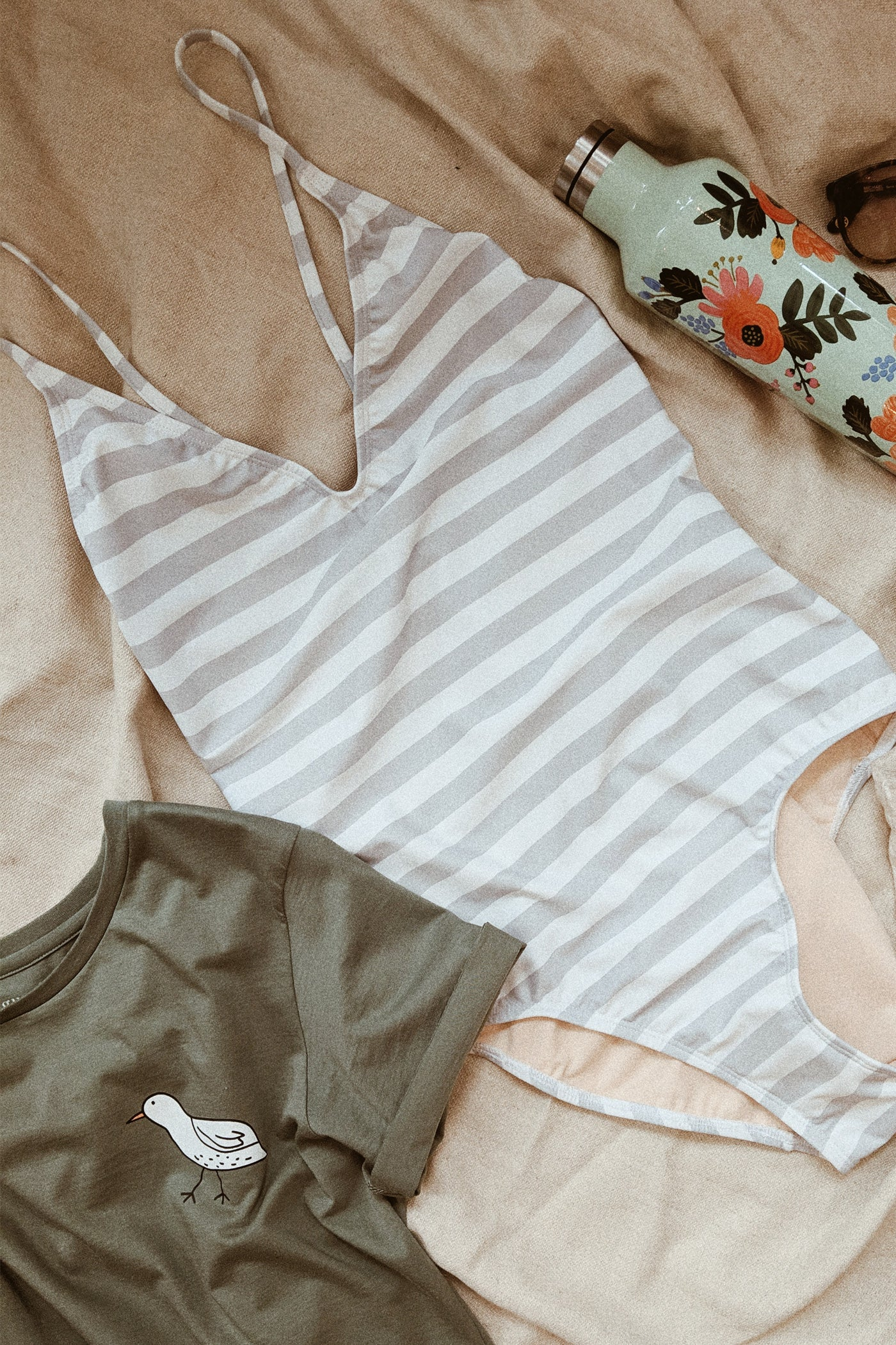 mimi hammer swimsuit grey stripes laying in bed by mimi & august