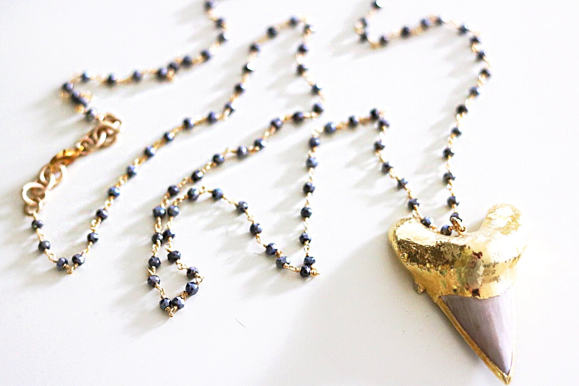 Sharks tooth necklace with 24k Gold-filled Dipped Shark's Tooth  Featured on Petite Pyrite and Wire-wrap Chain.