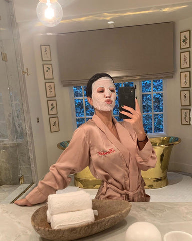 Kourtnery Kardashian wearing a sheet mask