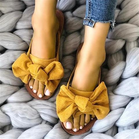 Bow-toe flat-bottomed slippers