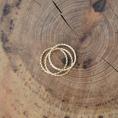 Twisted Stacking Rings