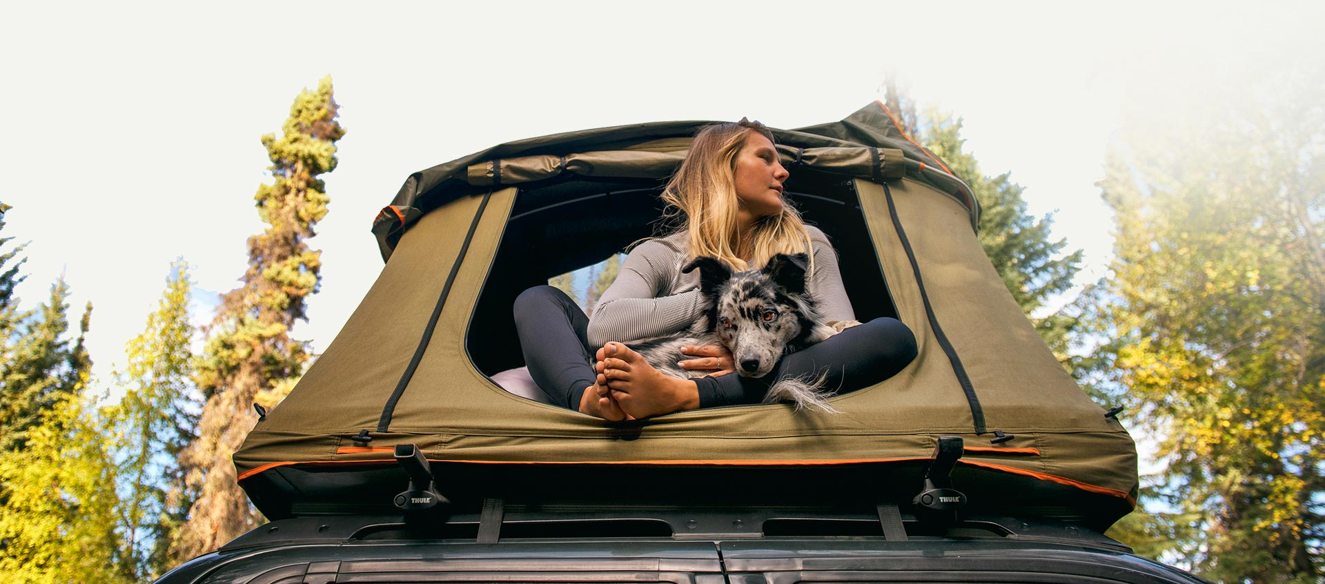 Sitting in the roof top tent with her dog