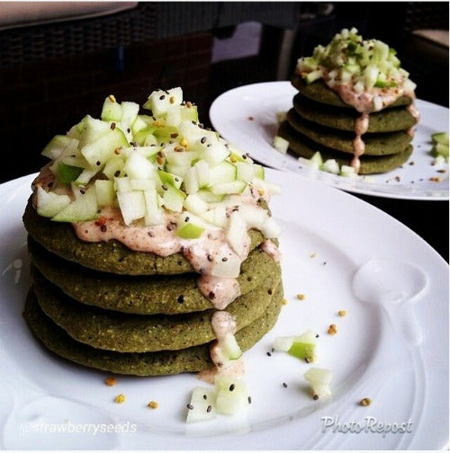 Healthy and balanced recipe with homemade pancakes with matcha green tea, served with vegan almond butter, apples and chia seeds
