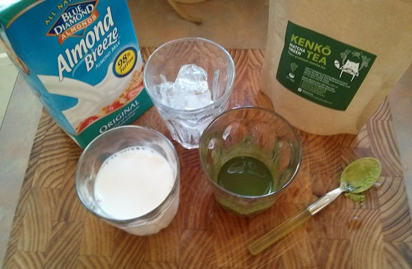 Ingredients for an iced almond milk matcha latte, with almond breeze and kenko matcha tea