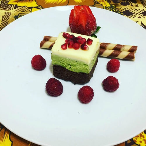 Green Tea Matcha Chocolate Trio Cake, Flourless, Served with fruits, with 3 layers of white chocolate, dark chocolate, matcha