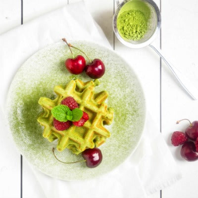 Matcha waffles served with fruits