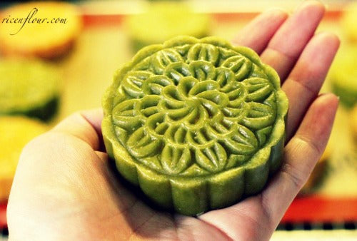 Traditional green tea matcha moon cakes filled with sweet rich red bean paste create the lovely festive dessert for Mid-autumn festival