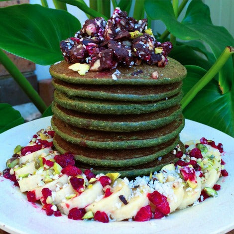 Vegan, dairy free, low fat Matcha pancakes recipe topped with dried fruits and nuts