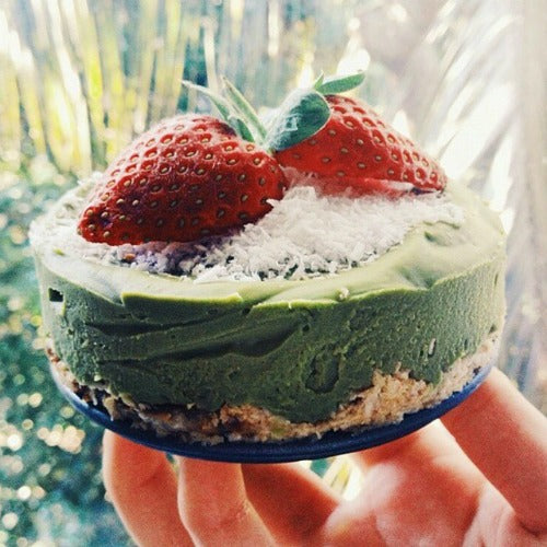 Vegan Matcha Lime Raw Cake topped with strawberry coconut