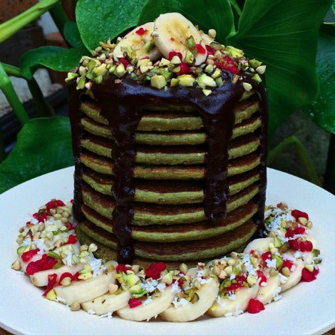 matcha green tea vegan pancakes with banana, dried fruits and maple syrup