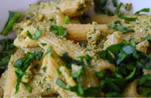 Green Tea Pesto Pasta garnished with chopped spinach. Delicious and nutritious vegan recipe