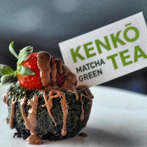 Green Tea Oreo chocolate cake topped with strawberry chocolate