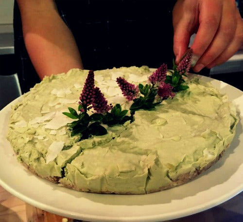 No baked green tea lime cake vegan recipe. It's made with matcha, coconut, lime, cashews, dates, and almonds