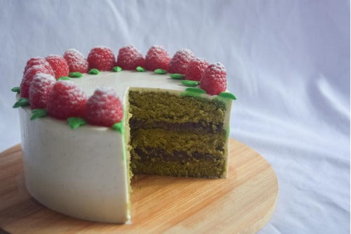 Green Tea Vanilla Cake with red bean paste and topped with raspberries