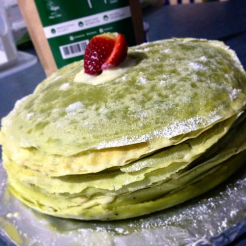 Thin, light matcha green tea crepes are layered with creamy custard filling to create the delicious stack of Matcha Crepe Cake