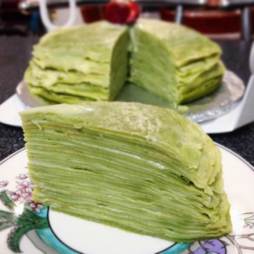 Matcha crepe cake layered with custard cream filling is the great breakfast or dessert for the family