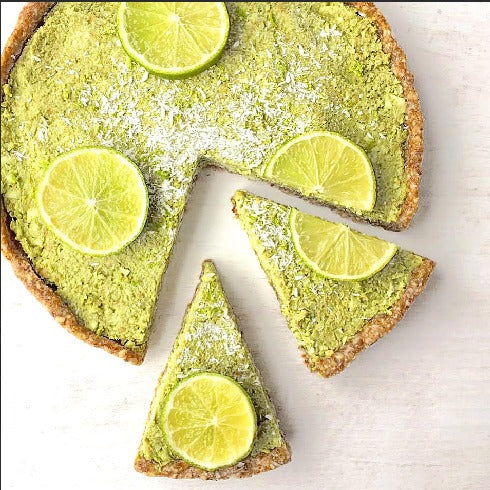 Vegan Raw Green Tea Lime Tart topped with coconut, lime zest, lime slices