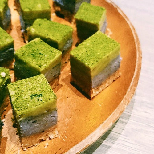 Mixed Berry Matcha White Chocolate Squares from vegan raw cake, dusted with matcha powder