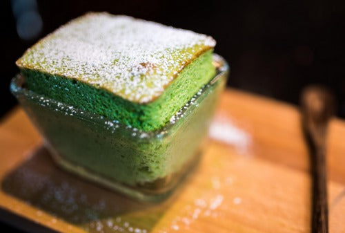 Classic green tea matcha souffle cake is soft and fluffy with a beautiful vibrant green color.