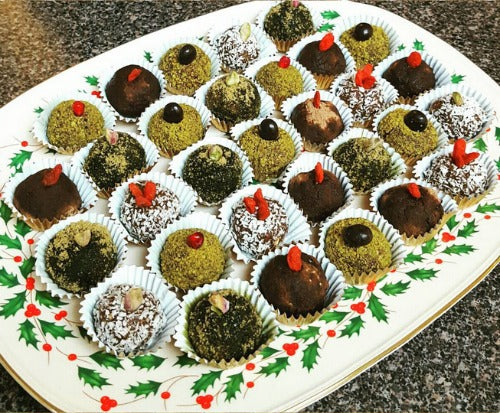Assorted Raw Matcha Truffle Balls. Sugar free, Dairy free, Raw, Vegan truffles with matcha, cacao, coconut, pistachio goji berries