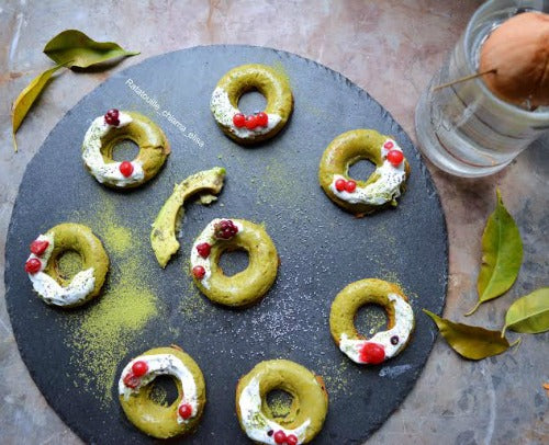 Green tea vegan donuts topped with favorite sauces and fruits to start your day healthily.