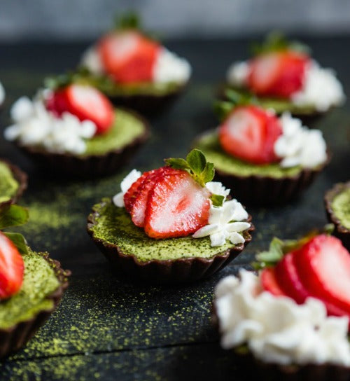 Vegan Raw Matcha Brownie Tarts topped with fresh strawberry are perfect for your party table or to share with family and mates