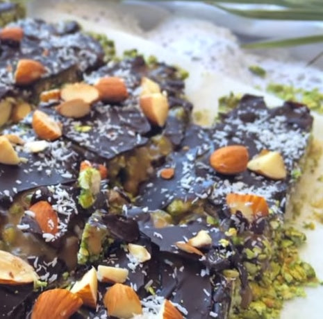 Vegan gluten free matcha green tea muesli bars with chocolate and caramel, almond and coconut topping