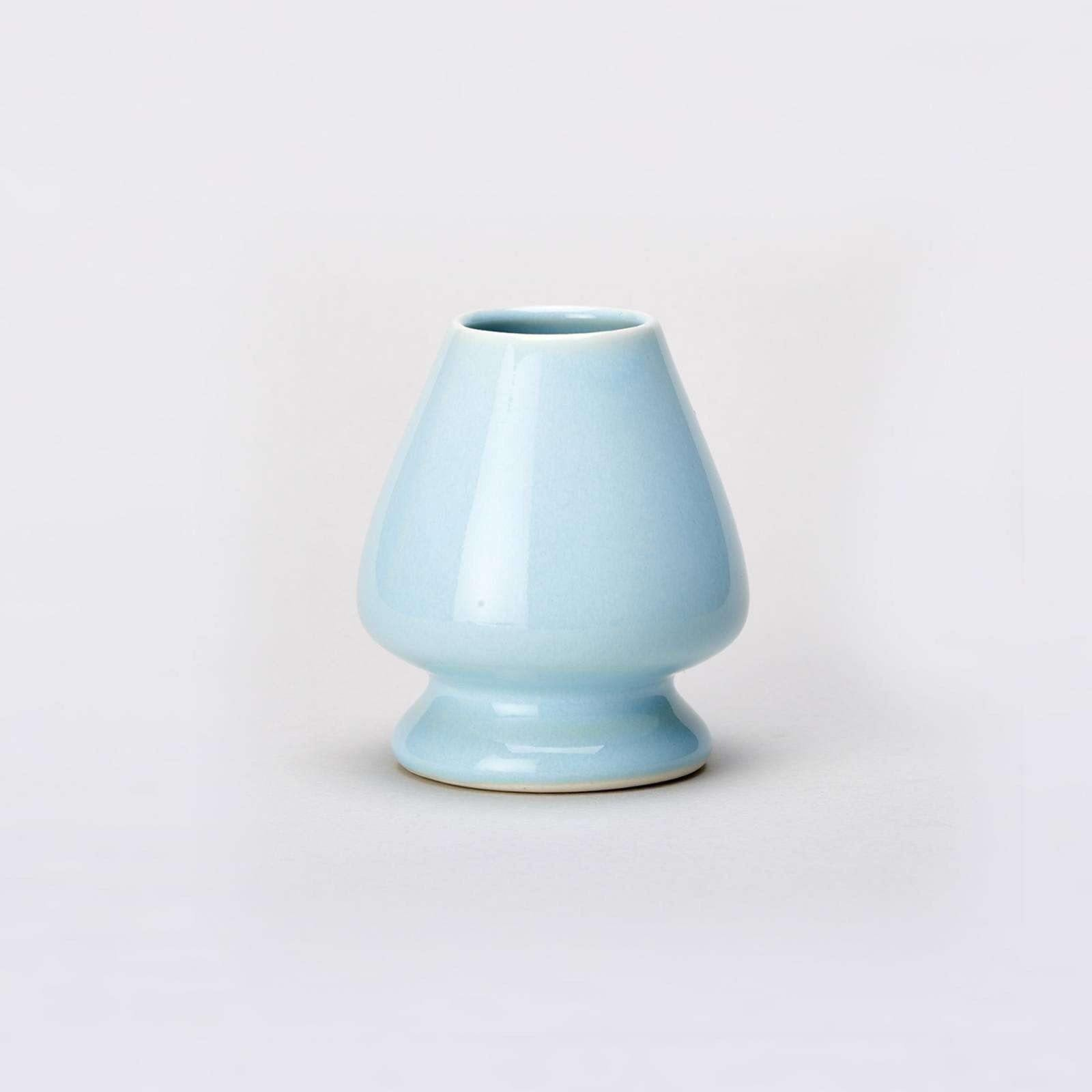 Blue Matcha Whisk stand on grey background
