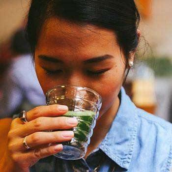 Gir Drinking Matcha Green Tea at japanese tea Ceremony