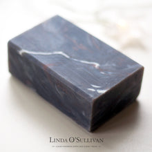 Load image into Gallery viewer, Marbled dark grey soap handcrafted by British soapmaker Linda O'Sullivan