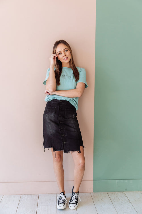 The Pemma Raw Hem Denim Skirt in Black