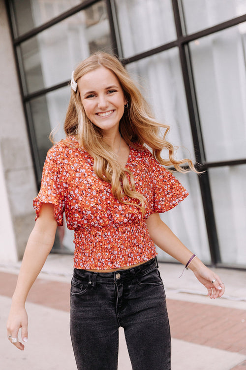 The Quayle Smocked Floral Top in Rust