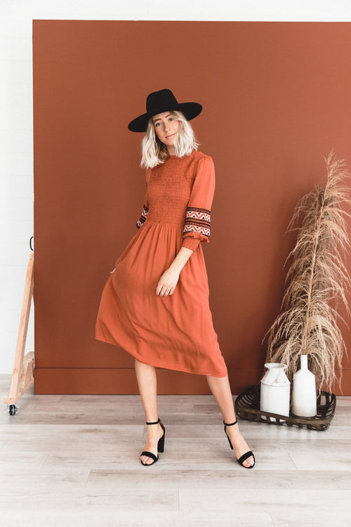 The Arwyn Smocked Midi Dress in Rust