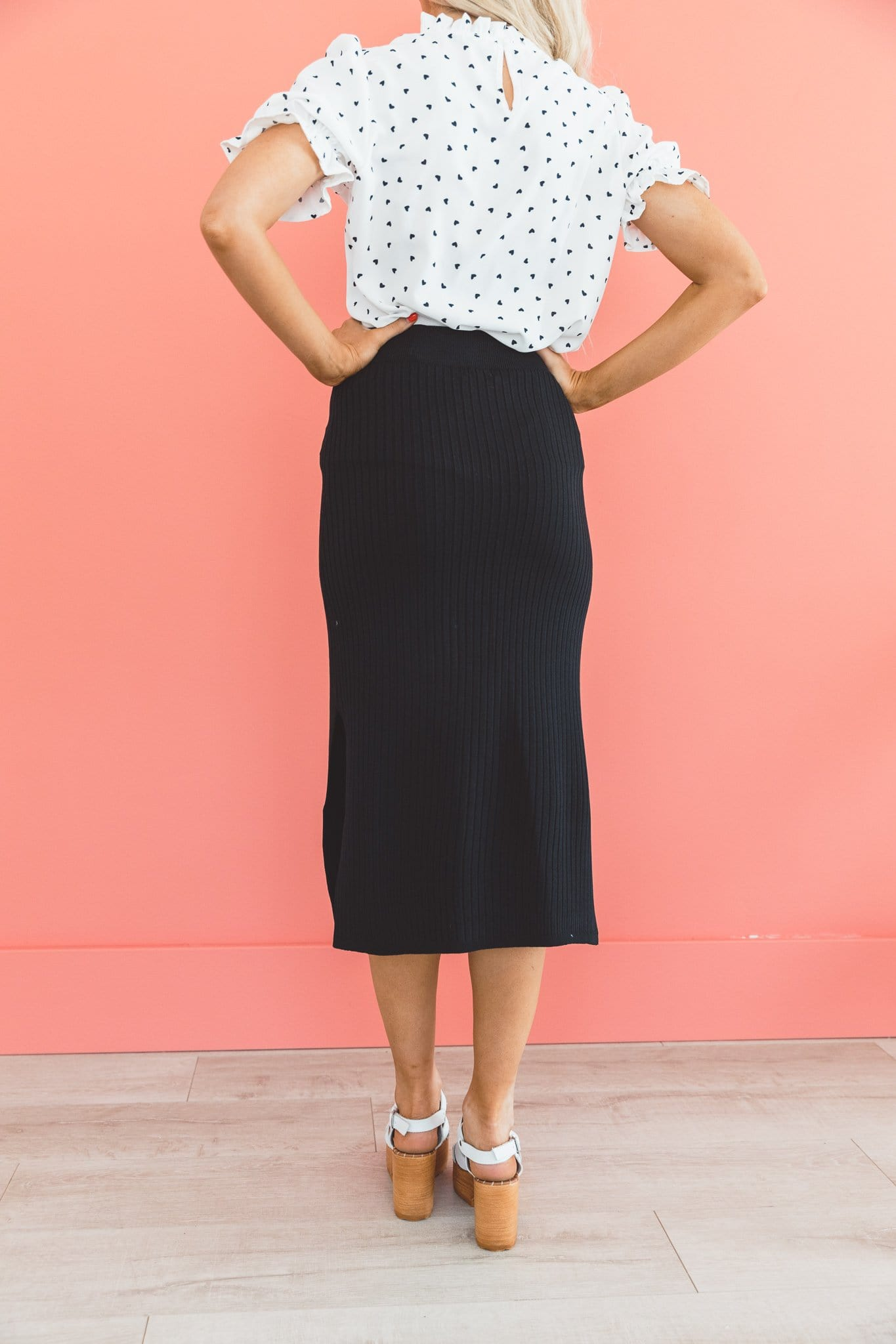 The Calan Fitted Midi Skirt in Black