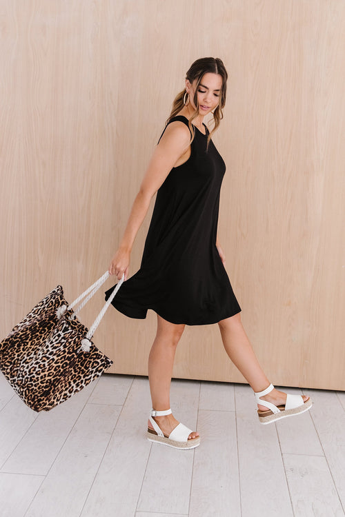 The Cameron Sleeveless Swing Dress in Black