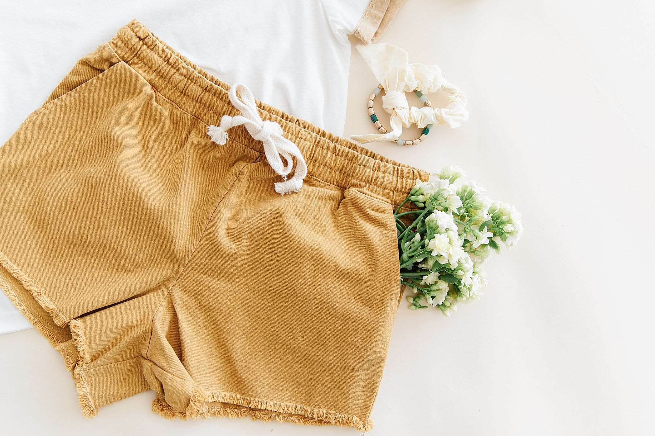 The Cooper Beach Shorts in Denim, Distressed Black, Mustard and Navy