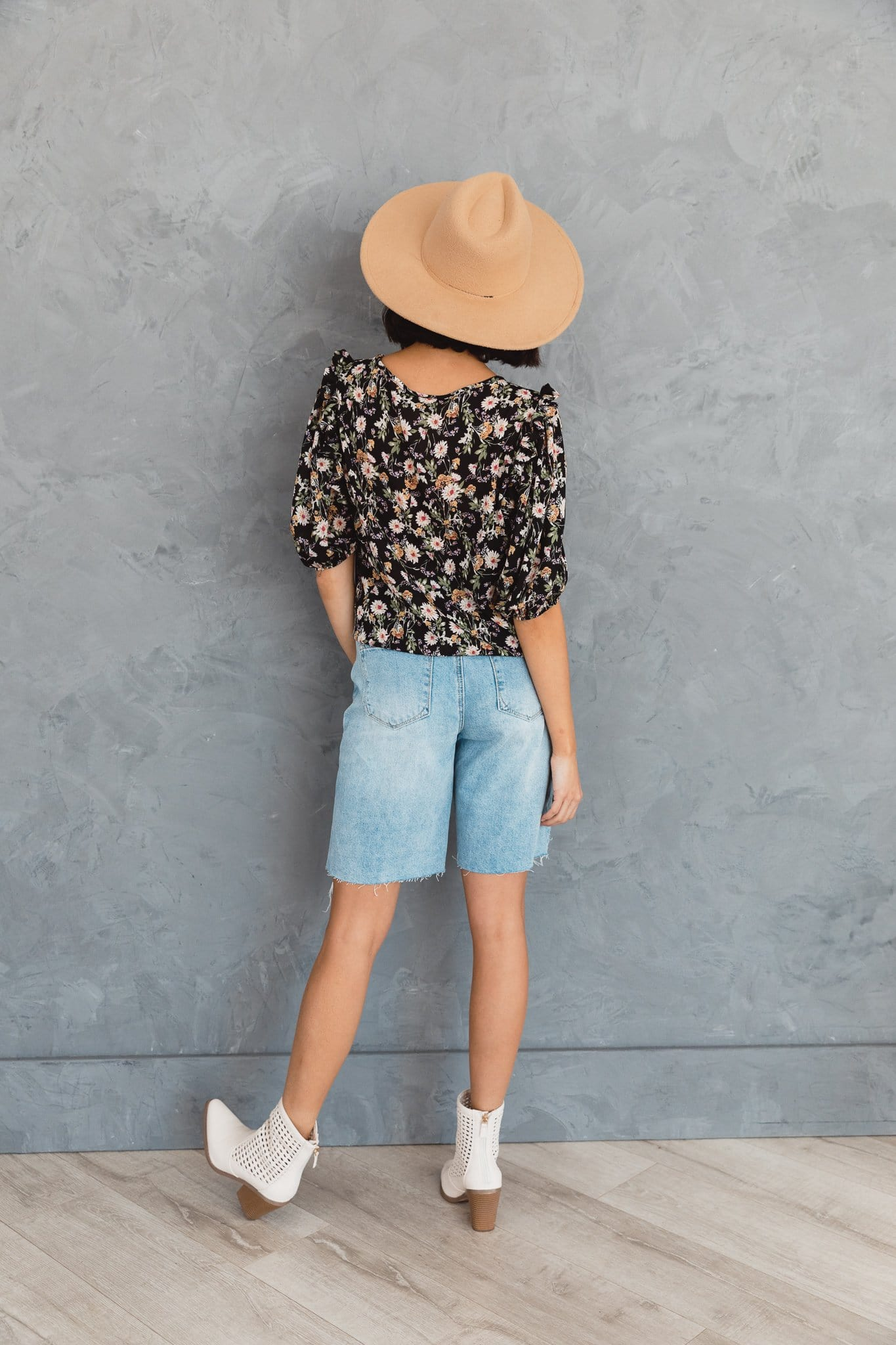 The Fara Ruffled Floral Top in Black